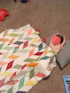 Quilt being used by a child