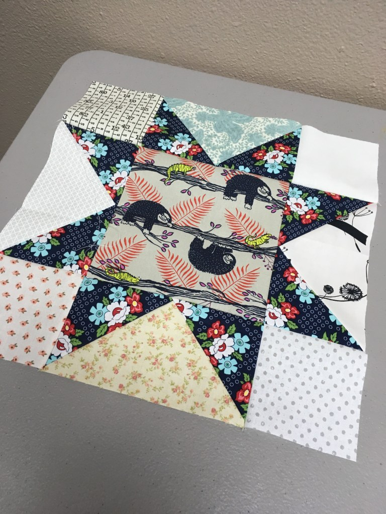 sawtooth quilt block floral with sloths