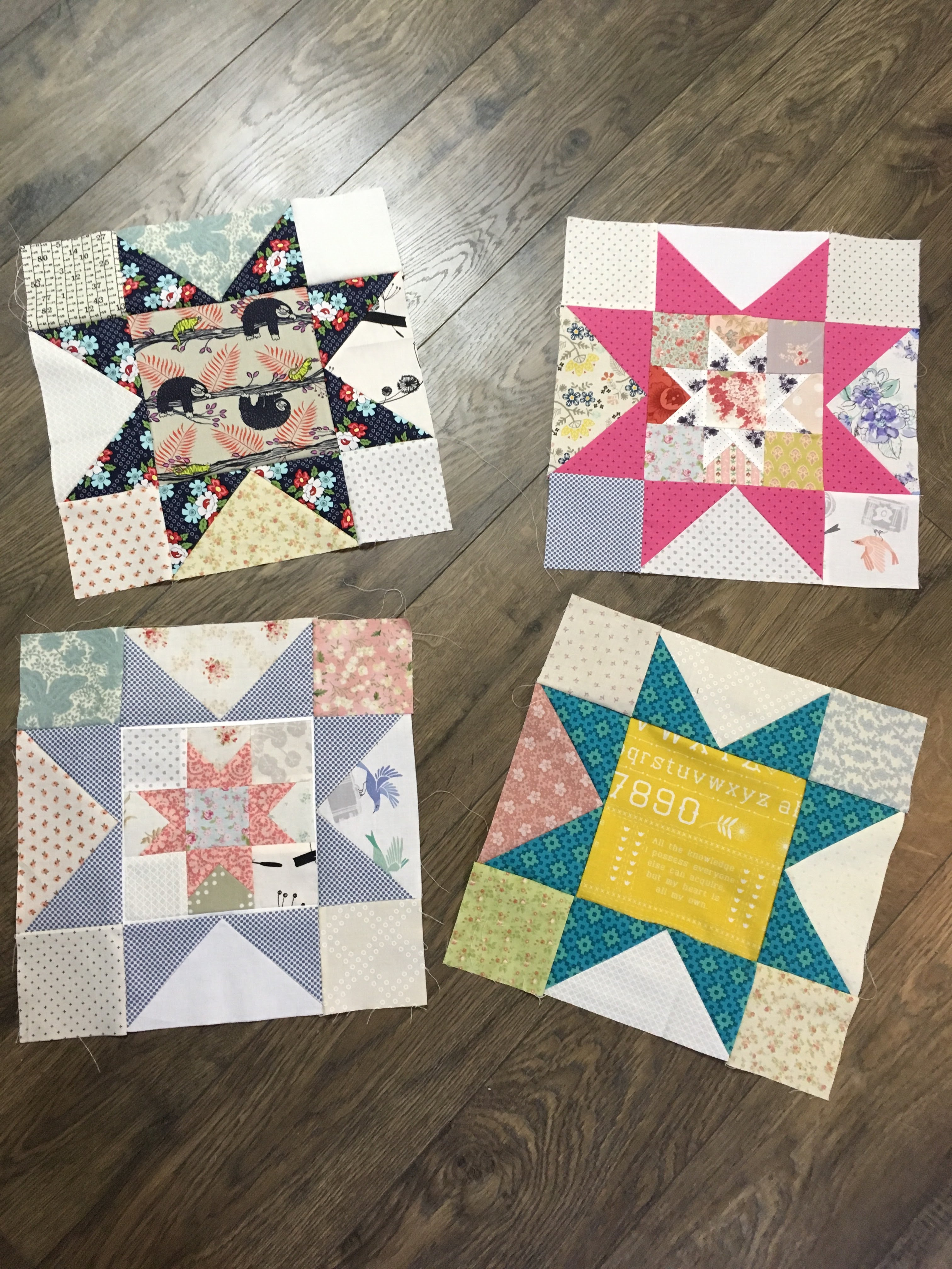 Four scrappy quilt blocks