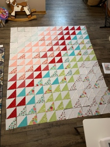 Colorful Quilt blocks laid on floor
