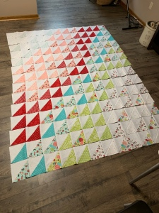 Quilt blocks webbed together laying on floor